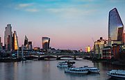 The evening light on the skyline of the building on the river Thames, which was nearly deserted at 7pm during the Coronavirus pandemic on 4th April 2020 in London, United Kingdom. The government clampdown includes the closure of most shops, bars and theatres throughout the country. One of the unforseen effects was a huge improvement in air quality, which gave a clarity to London views rarely seen before.