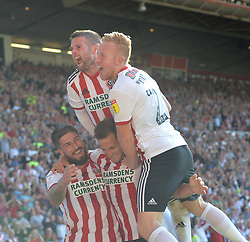Sheffield United's Billy Sharp (bottom) celebrates scoring his side's fourth goal of the game