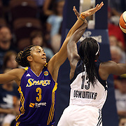 Chiney Ogwumike, (right), Connecticut Sun drives past Candace Parker, Los Angeles Sparks, during the Connecticut Sun Vs Los Angeles Sparks WNBA regular season game at Mohegan Sun Arena, Uncasville, Connecticut, USA. 3rd July 2014. Photo Tim Clayton