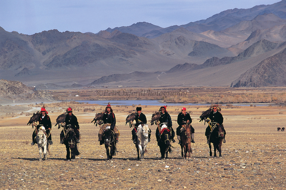 Kazakhs & Golden eagles<br /> (Aquila chrysaetos)<br /> arriving to Annual eagle festival<br /> Western Mongolia