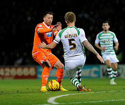 Yeovil Town's Byron Webster makes a tackle against Blackpool's Stephen Dobbie - Photo mandatory by-line: Joe Meredith/JMP - Tel: Mobile: 07966 386802 03/12/2013 - SPORT - Football - Yeovil - Huish Park - Yeovil Town v Blackpool - Sky Bet Championship
