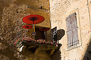Sun parasols on balcony veranda at gallery in popular picturesque tourist destination of Sarlat in the Dordogne, France