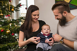 Parents with baby boy at home