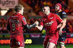 Scarlets' Aled Davies celebrates scoring his sides fifth try with Steffan Hughes<br /> <br /> Photographer Craig Thomas/Replay Images<br /> <br /> Guinness PRO14 Round 13 - Scarlets v Dragons - Friday 5th January 2018 - Parc Y Scarlets - Llanelli<br /> <br /> World Copyright © Replay Images . All rights reserved. info@replayimages.co.uk - http://replayimages.co.uk