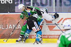 Brad Cole (HDD Tilia Olimpija, #2) vs Martin Mairitsch (EHC Liwest Linz, #86) during ice-hockey match between HDD Tilia Olimpija and EHC Liwest Black Wings Linz at fourth match in Semifinal  of EBEL league, on March 13, 2012 at Hala Tivoli, Ljubljana, Slovenia. (Photo By Matic Klansek Velej / Sportida)