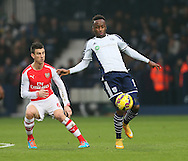 West Brom's Saido Berahino tussles with Arsenal's Laurent Koscielny<br /> <br /> Barclays Premier League- West Bromwich Albion vs Arsenal - The Hawthorns - England - 29th November 2014 - Picture David Klein/Sportimage