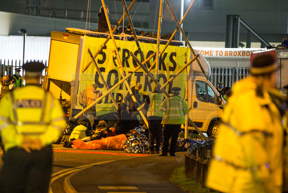 ©️ Licensed to London News Pictures. 05/09/2020. London, UK. Members of the Extinction Rebellion (XR) environmental campaign group maintain the blockade Broxbourne in Hertfordshire throughout the night using vehicles and bamboo lock-ons to try to prevent the Sun, Times, Telegraph and Mail newspapers from reaching newsstands on Saturday. XR plan to disrupt areas of central London with actions planned over the next two weeks, until MP's back the Climate and Ecological Emergency Bill and prepare for crisis with a National Citizens' Assembly. Photo credit: Marcin Nowak/LNP