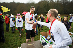 © Licensed to London News Pictures. 03/03/2019. Dorking, UK. Beer being handed out to competitors after they take part in the 2019 annual Wife Carrying Race in Dorking, Surrey. Run over a course of 380m, with both men and women carry a 'wife' over obstacles, the race is believed to have originated in the UK over twelve centuries ago when Viking raiders rampaged into the northeast coast of England carrying off any unwilling local women . Photo credit: Ben Cawthra/LNP