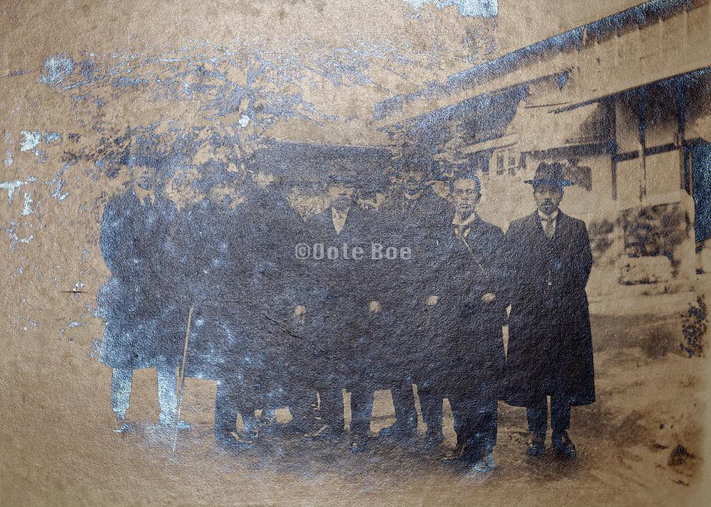 silver mirroring vintage group portrait with businessmen Japan