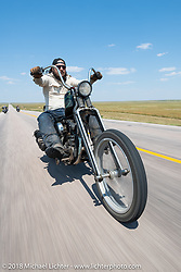 Danger Dan riding his Shovelhead chopper in the Cycle Source Ride during the 78th annual Sturgis Motorcycle Rally. Sturgis, SD. USA. Wednesday August 8, 2018. Photography ©2018 Michael Lichter.