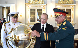 July 30, 2017 - Saint Petersburg, Russia - July 30, 2017. - Russia, Saint Petersburg. - Russian President Vladimir Putin visits the Main Admiralty historical building in St. Petersburg on Russian Navy Day. Left: Russian Navy Commander-in-Chief, Admiral Vladimir Korolyov. Right: Defense Minister, Army General Sergey Shoigu. (Credit Image: © Russian Look via ZUMA Wire)