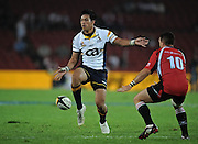 Brumbies Flyhalf, Christian Lealiifano kicks the ball with Andre Pretorius in defence in the Super 14 match between the Lions and the Brumbies that took place on Saturday 21 March 2009 at Coca-Cola Park in Johannesburg South Africa. The Lions won this Super 14 match against the Brumbies 25 - 17.  <br /> Photographer : Anton de Villiers / SASPA