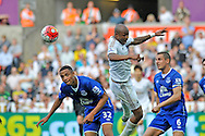 Andre Ayew of Swansea City beats Brendan Galloway (32) of Everton to the ball in the second half.<br /> Barclays Premier League match, Swansea city v Everton at the Liberty Stadium in Swansea, South Wales on Saturday 19th September 2015.<br /> pic by Phil Rees, Andrew Orchard sports photography.