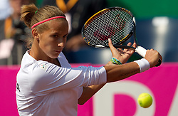 Polona Hercog of Slovenia  returns the ball to Eugenie Bouchard of Canada during the first day of the tennis Fed Cup match between Slovenia and Canada at Bonifika, on April 16, 2011 in Koper, Slovenia.  (Photo by Vid Ponikvar / Sportida)