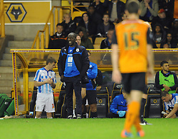 Huddersfield Town Manager, Chris Powell looks on from the bench - Photo mandatory by-line: Dougie Allward/JMP - Mobile: 07966 386802 - 01/10/2014 - SPORT - Football - Wolverhampton - Molineux Stadium - Wolverhampton Wonderers v Huddersfield Town - Sky Bet Championship