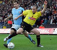 Fotball<br /> FA Cup England 2004/2005<br /> 3. runde<br /> 08.01.2005<br /> Foto: SBI/Digitalsport<br /> NORWAY ONLY<br /> <br /> Watford v Fulham<br /> <br /> Fulham's Carlos Bocanegra tackles Watford's Jermaine Darlington from behind.