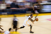 Golden State Warriors forward Andre Iguodala (9) dribbles the ball down the court against the LA Clippers at Oracle Arena in Oakland, Calif., on February 23, 2017. (Stan Olszewski/Special to S.F. Examiner)