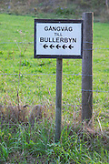Sign: walking path to Bullerbyn. The original location where Astrid Lindgren's story on Bullerbyn was filmed. In reality called Sevedstorp. Smaland region. Sweden, Europe.