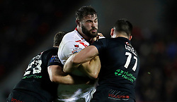 St Helens Saints' Alex Walmsley is tackled by London Broncos' Rob Butler (let) and Will Lovell (right), during the Betfred Super League match at the Totally Wicked Stadium, St Helens.