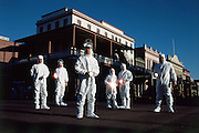 """Chip workers in clean room """"bunny"""" suits, in old town of Austin, Texas. Austin is known for its music and old world charm as well as it's embrace of the technology sector."""
