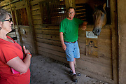 HUSTLE, VIRGINIA - JULY 26: Randy Silvers and Carolyn Berry in the horse barn on their Rock Spring Farm on Sunday, July 26, 2015 in Hustle, Virginia. The couple are giving away their 18th-century horse farm, that Silvers and his first wife rebuilt and restored, by hand-picking the next owner to the winner of an essay contest. (Photo by Pete Marovich For The Washington Post)
