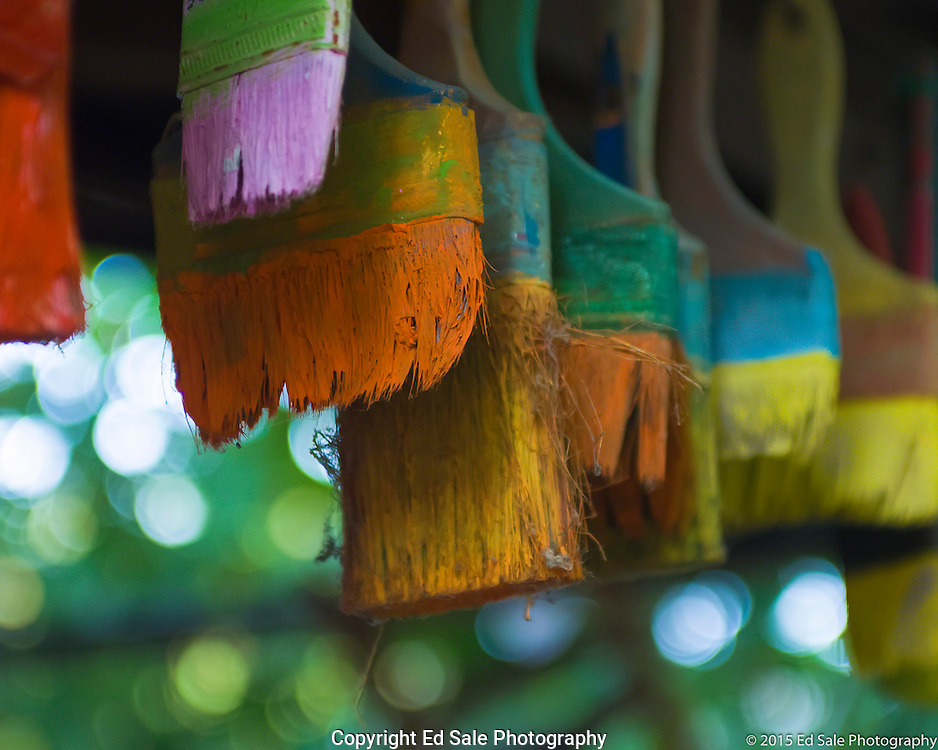Colorful paint brushes hang from the porch of The Art Shack in Locke, California