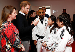 The Duke of Sussex speaks to participants of a Jiu-jitsu session during a visit to Streatham Youth and Community Trust's John Corfield Centre to see a 'Fit and Fed' February half-term holiday activity programme.