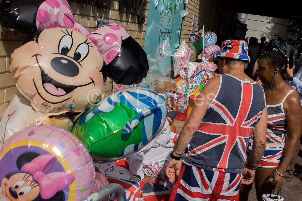 Royalists and Disney balloons as tension mounts outside St Mary's Hospital, Paddington London, where media and royalists await news of Kate, Duchess of Cambridge's impending birth to a baby boy. Some have been camping out for up to two weeks during a UK heatwave, having bagged the best locations where the heir to the British throne will eventually be shown to the waiting world.