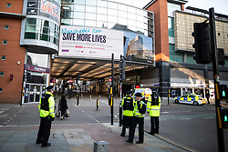 © Licensed to London News Pictures. 26/03/2020. Manchester, UK. A man is handcuffed and detained by police in Manchester City Centre , in suspicion of stealing a mobile phone from a pedestrian . Manchester City Centre lies nearly empty during a sunny spring afternoon . The British government has imposed a lockdown on all but essential activities and instructed people to reduce social contact as part of quarantine measures to prevent the spread of Coronavirus ( COVID-19 ) . Photo credit: Joel Goodman/LNP