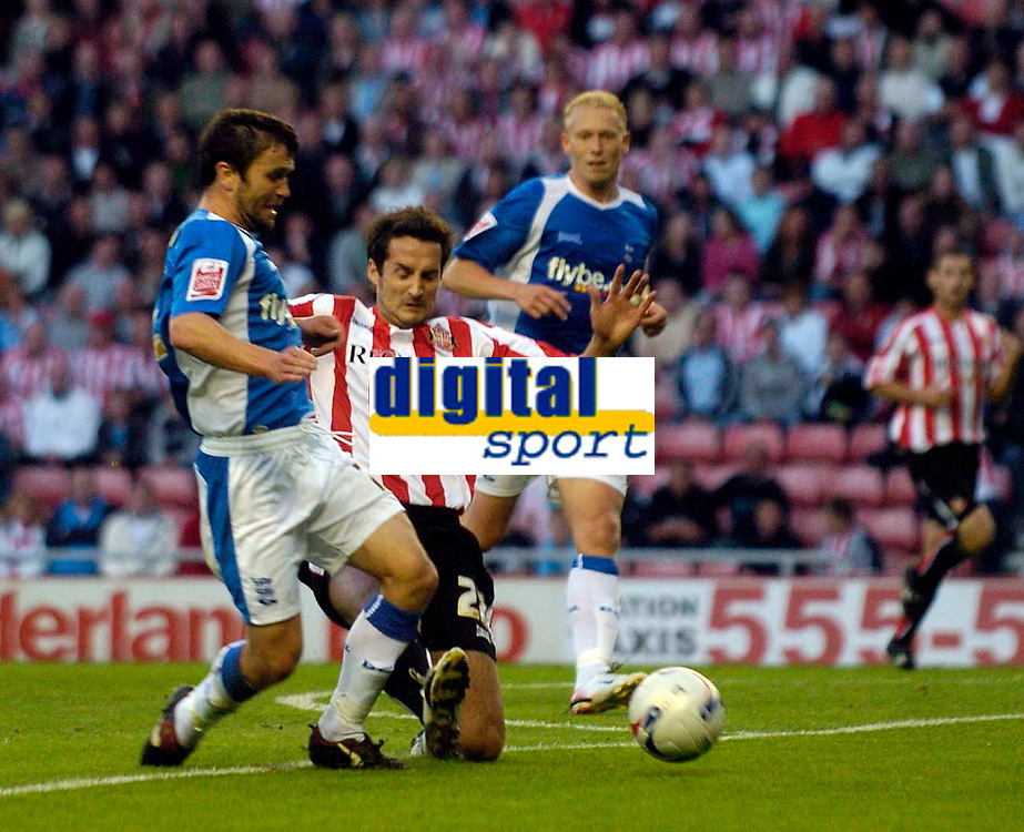 Photo: Jed Wee.<br /> Sunderland v Birmingham City. Coca Cola Championship. 09/08/2006.<br /> <br /> Birmingham's Damien Johnson (L) goes down under a challenge from Sunderland's Clive Clarke to earn a penalty.