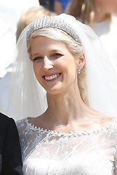 Newlywed Lady Gabriella Windsor smiles on the steps of the chapel after their wedding at St George's Chapel in Windsor Castle.