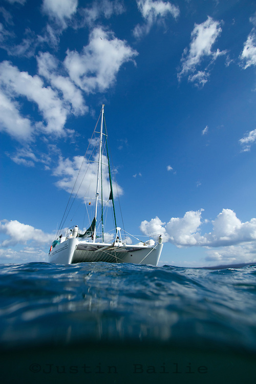 Over under image of catamaran in the Galapagos Islands, Ecuador.