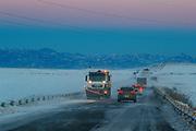 Municipality employees salt the snowy M2 highway, on  Sunday, Jan 24, 2021 - in southern Armenia's Syunik region near Goris, during a heavy snowstorm. (Photo/ Vudi Xhymshiti)