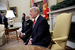 June 26, 2017 - Washington, District of Columbia, United States of America - United States President Donald Trump meets with Indian Prime Minister Narendra Modi in the Oval Office of the White House June 26, 2017 in Washington, DC. Trump and Modi are scheduled to deliver joint statements later today following their meetings.   .Credit: Win McNamee / Pool via CNP (Credit Image: © Win Mcnamee/CNP via ZUMA Wire)