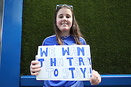 """a Chelsea fan holding up a sign """"We Want John Terry To Stay!!"""" outside Stamford Bridge before k/o. Barclays Premier league match, Chelsea v Leicester city at Stamford Bridge in London on Sunday 15th May 2016.<br /> pic by John Patrick Fletcher, Andrew Orchard sports photography."""