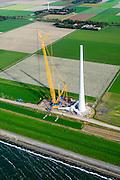 Nederland, Flevoland, Noordoostpolder, 10-10-2014. Westermeerdijk, ten noorden van Urk. Bouw van het grootste windmolenpark van Nederland, Windpark Noordoostpolder. Het windmolenpark van de Koepel Windenergie Noordoostpolder is een initiatief van NOP Agrowind, energiebedrijf RWE/Essent en Westermeerwind <br /> Construction of the largest wind farm in the Netherlands, Wind farm Northeast Polder.<br /> luchtfoto (toeslag op standard tarieven);<br /> aerial photo (additional fee required);<br /> copyright foto/photo Siebe Swart