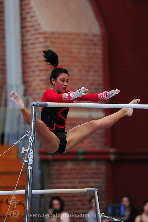 January 23, 2011; Stanford, CA, USA; Stanford Cardinal gymnast Allyse Ishino performs on the bars during the meet against the UCLA Bruins at Burnham Pavilion. The Cardinal defeated the Bruins 196.200-194.825. Mandatory Credit: Kyle Terada-Terada Photo