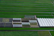 Nederland, Zuid-Holland, Gemeente  Kaag en Braassem, 09-04-2014; Woubrugge, kassen en kwekerijen, omgeven door weiland in het Groene Hart.<br /> Greenhouses, nurseries and fields in the Green Heart (West-Holland).<br /> luchtfoto (toeslag op standaard tarieven);<br /> aerial photo (additional fee required);<br /> copyright foto/photo Siebe Swart.