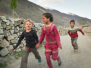 A young tourist boy run with a local girl.<br /> Life in Chipursan valley. It is the most Northwestern part of Pakistan, bordering Afghanistan and China. The people speak the Wakhi Language and belong to the Ismaili sect of Islam.