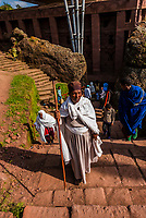 Worshippers leaving Bet Medhane Alem, one of 11 rock hewn medieval monolithic churches in Lalibela, Ethiopia.