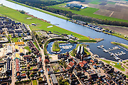 Nederland, Overijssel, Gemeente Steenwijkerland, 01-05-2013; Vollenhoven, met jachthaven en gezien naar de Noordoostpolder. In het centrum de Grote of Sint Niklaaskerk (laat-gotische hallenkerk).<br /> Marina and old church in the village of Vollenhove in the polder.<br /> luchtfoto (toeslag op standard tarieven)<br /> aerial photo (additional fee required)<br /> copyright foto/photo Siebe Swart