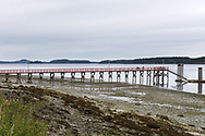 View of the Fernwood Dock at the north end of Salt Spring Island in British Columbia, Canada.  The channel in the background is Trincomali Channel and Wallace island.