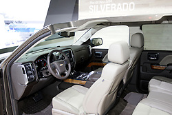 08  February 2013: 2014 GMC Sierra Terrain pickup truck.  Chicago Auto Show, Chicago Automobile Trade Association (CATA), McCormick Place, Chicago Illinois<br /> <br /> 2014 GMC SIERRA: Come to the 2013 Chicago Auto Show and witness the Chicago debut of the most advanced truck in GMC's 110-year history. It's the next generation, 2014 GMC Sierra 1500 full-size pickup with an updated engine portfolio for increased power, torque and fuel efficiency across the board. There is a 4.3 liter V-6, a 5.3L V-8 and a 6.2L V-8 offered, all from a shared EcoTec3 engine family. Each of the powerplants is connected to a six-speed automatic transmission with auto grade braking. Premium materials, attention to detail and purposeful technology define Sierra's all-new cabin. Redesigned instrument cluster is available with a centrally located, 4.2-inch color driver information center. Sierra is offered with a 110-volt outlet, up to five USB ports, four 12-volt outlets and an SD card slot. The Crew Cab, representing more than 60 percent of retail Sierra buyers, has cabins for five or six passengers, and a choice between the current 5-foot, 8-inch box, or a new 6-ft, 6-in box. Regular cabs (2/3 passenger) continue with the 6-ft, 6-in. or 8-ft box lengths, while the extended cab (5/6 seater) come exclusively with a 6-ft, 6-in. box. For the first time on Extended Cab models, is a front-hinged rear doors with outside pull handles at the rear. A suite of active safety features help with forward collision alert and lane departure warning. Note that the Sierra All-Terrain package on extended and crew cab models wear unique styling for 2014, counting a painted grille and less chrome. The All-Terrain is available with special paint colors and the highly-praised Z71 off-road suspension.