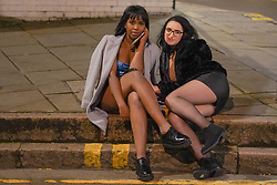 © Licensed to London News Pictures. 09/10/2020. Nottingham , UK.  Revellers enjoy a night out in the city center of Nottingham. Following a spike in Coronavirus cases,Prime Minister Boris Johnson is expected to announce that all pubs and restaurants in the North and North East of England-the areas worst hit by Covid-19- will have to shut their doors for two weeks.  Photo credit: Ioannis Alexopoulos/LNP