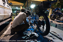 Yoshimasa Niimi and Shinya Kimuro of Japan work on their Team-80 1915 Indian in a Palm Desert hotel parking lot during the Motorcycle Cannonball Race of the Century. Stage-15 ride from Palm Desert, CA to Carlsbad, CA. USA. Saturday September 24, 2016. Photography ©2016 Michael Lichter.