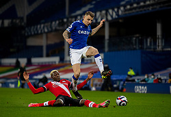 LIVERPOOL, ENGLAND - Monday, March 1, 2021: Everton's Lucas Digne (R) is tackled by Southampton's Moussa Djenepo during the FA Premier League match between Everton FC and Southampton FC at Goodison Park. Everton won 1-0. (Pic by David Rawcliffe/Propaganda)