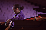 Jazz Pianist Joel Martin poses at his piano before a performance.