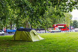 A tent capable of accommodating several people is pitched on the traffic island on Park Lane near marble Arch. Over the last few years London has seen increasing numbers of Eastern European beggars and street performers on its streets as they flock to the UK and other wealthier countries to take advantage of people's generosity. London, August 02 2019.