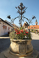 Well in the main square, Rust ( Hungarian: Ruszt ) on the Neusiedler See, Burgenland, Austria .<br /> <br /> Visit our AUSTRIA PHOTO COLLECTIONS for more photos to download or buy as wall art prints https://funkystock.photoshelter.com/gallery-collection/Pictures-Images-of-Austria-Photos-of-Austrian-Historic-Landmark-Sites/C0000VRQ9JIAzOxc