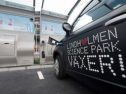 Electric cars being recharged at plug-in station at Lindholmen Science Park in Gothenburg Sweden